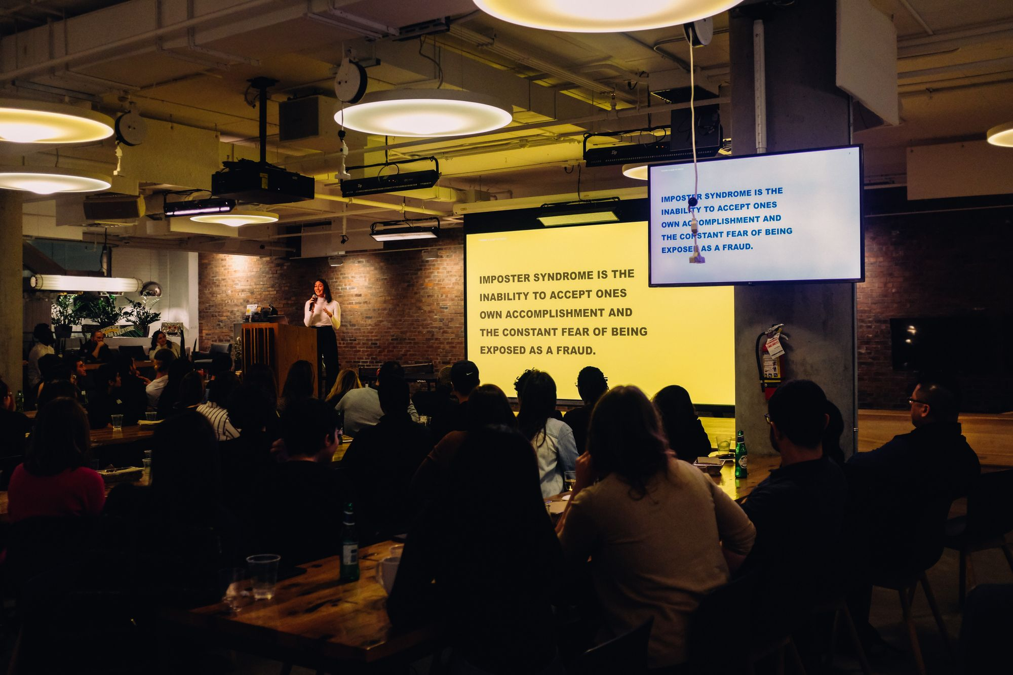 an asian woman gives a tech talk about imposter syndrome