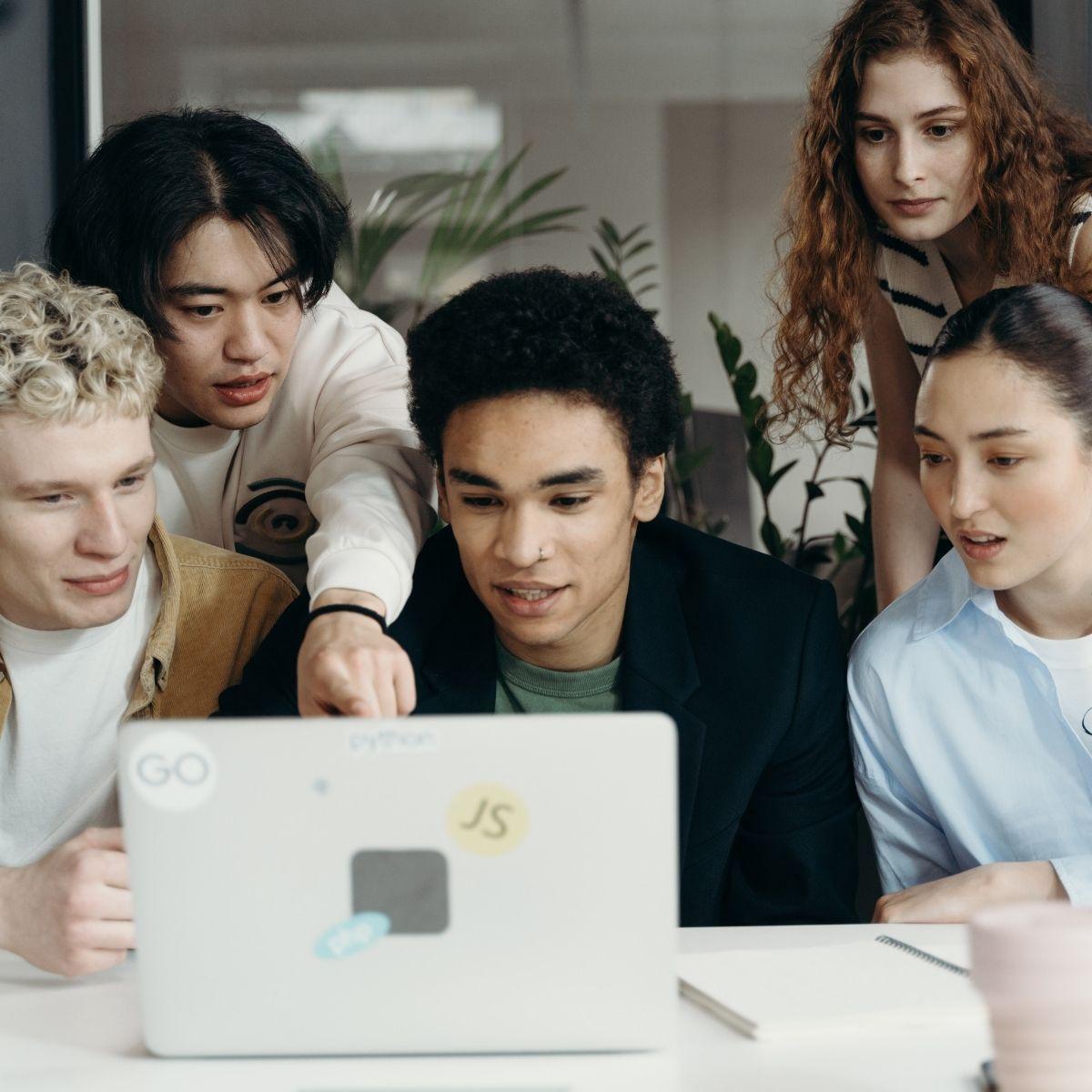 group crowds around computer screen