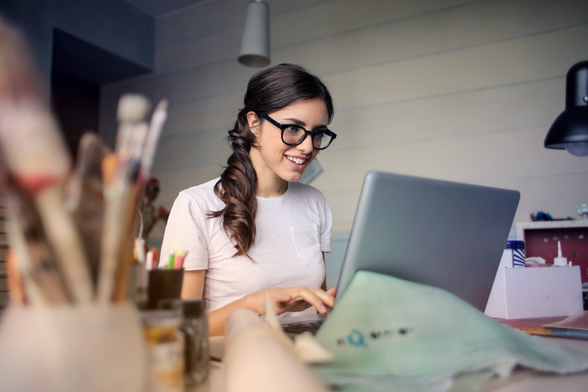 Girl happily typing away at computer